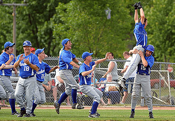 Logan McLaughlin of Central Aroostook High School jumps into the arms of teammate Kasey Brewer (15) to celebrate the Panthers' first Eastern Maine Class D baseball title since 2003 last season. McLaughlin, a senior, hopes to return early in the season to help the Panthers defend their title.