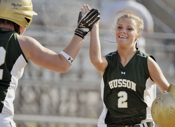 Husson sophomore Courtney Hill (2) is all smiles as she scores in the first inning of their game against UMaine in Orono, Tuesday, April 12, 2011. Maine won 10-2.