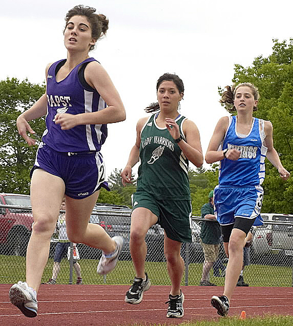 John Bapst's Maggie Bryan leads Fort Kent's Gabby Naranja and Faith Mackey of Searsport during the 800-meter run at the PVC Small School Track and Field championships last spring. Bryan is one of Bapst's key returnees as the Crusaders look to defend their conference and state championships.