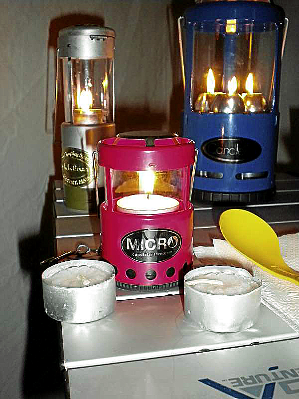 The Uco family of candle lanterns includes the Micro (front), the traditional one-candle (left rear) and the Chandlelier three-candle model (right rear).