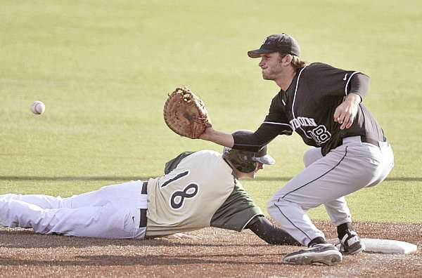 Shawn Smith (18) of Husson University dives back safely to first base ahead of the tag from Dan Hicks of Bowdoin College of Brunswick in the fifth inning of the first game of their baseball doubleheader Monday at Winkin Complex in Bangor. Husson won the opener 8-2, and Bowdoin took the nightcap 8-4.