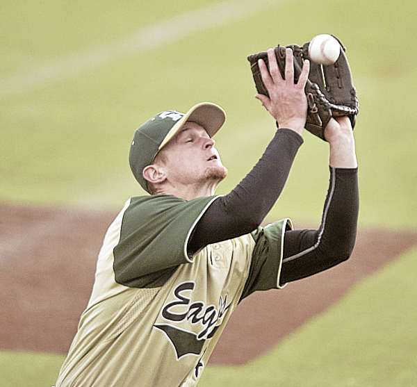 Husson pitcher Nathan Adams puts the squeeze on an infield foul ball for the out in the fifth inning of game one of Monday's doubleheader with Bowdoin College in Bangor. The host Eagles won the opener 8-2, and the Polar Bears of Brunswick won the second 8-4.