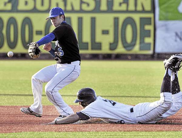 Joey Martin of the University of Maine slides safely into second with a stolen base as Colby's Taro Gold tries to snare the throw during Tuesday's game at Mahaney Diamond in Orono. The Black Bears won 4-2.