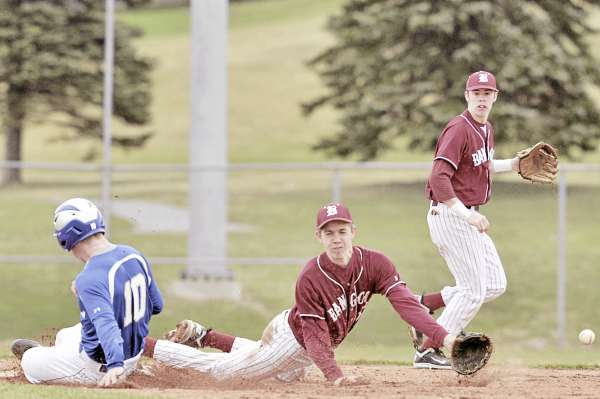 Bangor second baseman Seth Freudenberger (center) and shortstop Jack Stacey (right) watch the ball skip by as Lawrence of Fairfield's Shawn Russell steals second base during the third inning of Thursday's Class A baseball season opener at Mansfield Stadium in Bangor. Bangor rolled to a 19-7 victory in a game halted after 4 1/2 innings.