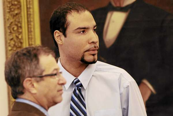 Edgard Anziani, standing next to his attorney, Jeffery Silverstein, looks toward the gallery in courtroom 202 at the Penobscot Judicial Center on Thursday, April 21, 2011, after pleading guilty to manslaughter in the Feb. 23, 2010, death of 15-month-old Damien Lynn.