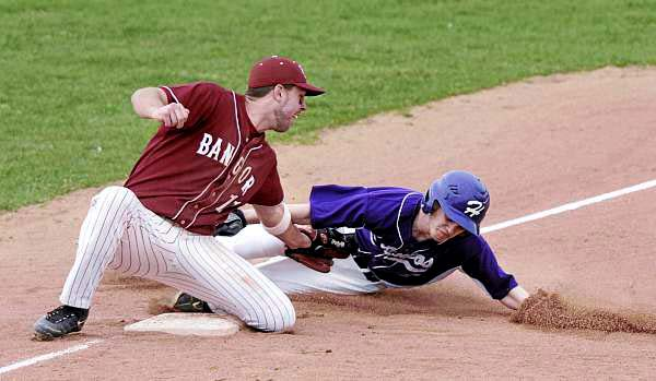 Bangor third baseman Adam King tags out Hampden Academy baserunner Nick Rodgerson after Rodgerson attempted to advance from second on a pitch in the dirt during the third inning of Monday's Class A baseball game at Mansfield Stadium in Bangor.