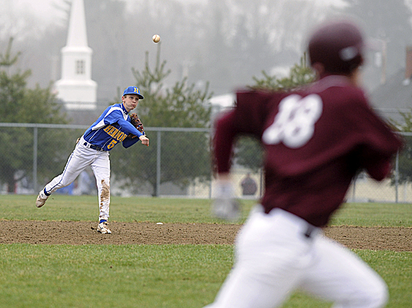 Ellsworth's Thomas Sawyer (18) runs toward first base, trying to beat a throw from Hermon shortstop Reid McGinley during the third inning of Wednesday's Class B baseball game at Ellsworth. Sawyer reached base on the play. Ellsworth won 5-0.