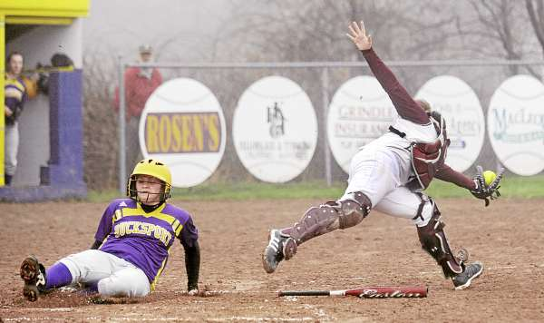 Bucksport High School's Debbie Wight (left) slides safely home as Ellsworth catcher Cristin Wright stretches for the ball during the the third inning Thursday in Bucksport.