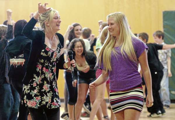 Agnete Kjerstad (left) and Elise Toft (right), lead students in a traditional Norwegian dance during International Day at Wagner Middle School in Winterport on Friday, April 29, 2011. Kjerstad and Toft, who both hail from Norway, were among the 20 exchange students representing 16 countries who performed entertaining educational presentations about their home countries during the event. The exchange students arrived last August and have been attending school at numerous regional high schools, including Bangor High School, Hampden Academy, Orono High School, Brewer High School, John Bapst Memorial High School, and Caribou High School.