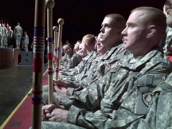 1136th soldiers look at the walking sticks just given to them by World War II veteran Galen Cole at the unit's Freedom Salute on Friday at the University of Maine's Collins Center for the Arts.