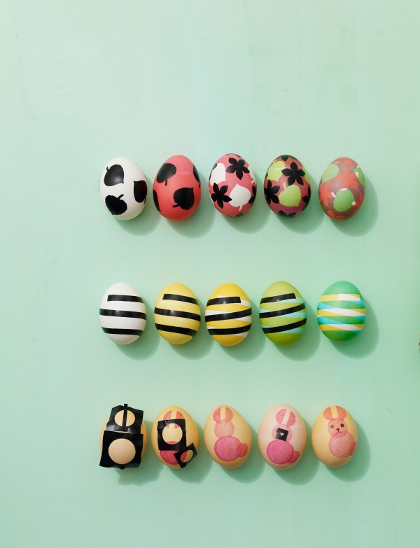 It only takes a few simple tools to create detailed Easter egg designs: Try making patterns with punched shapes (top row), strips of electrical tape (middle) and stencils (bottom).
