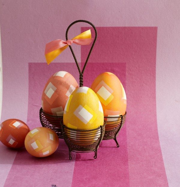 Bright colors and geometric designs make modern-looking eggs. To create this pattern, pieces of electrical tape are shifted slightly between two dips in dye.