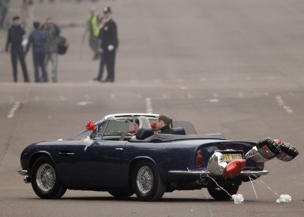 Britain's Prince William and his wife Kate, Duchess of Cambridge drive away from Buckingham Palace in a convertible after the Royal Wedding in London Friday, April, 29, 2011.