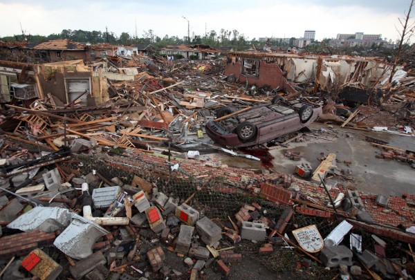 A car lies overturns and buildings destroyed in Tuscaloosa, Ala., Wednesday, April 27, 2011. A wave of severe storms laced with tornadoes strafed the South on Wednesday; buildings across swaths of the university town were damaged or destroyed.