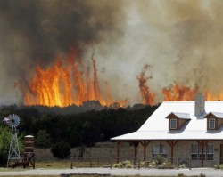 Firefighters make some progress against Texas' largest blaze