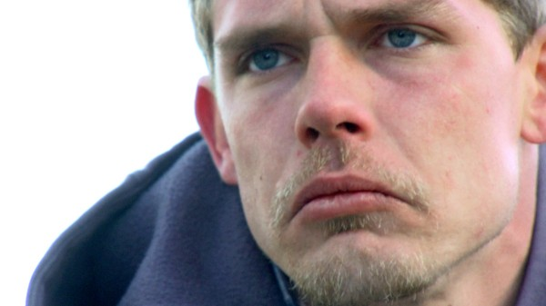 "Connor (Matthew Pennington) during a reflective moment on the water in the short film ""A Marine's Guide to Fishing""."