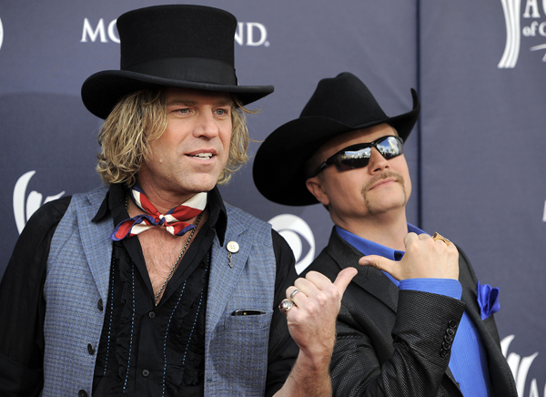 Kenny Alphin, left, and John Rich of 'Big and Rich' arrive at the 46th Annual Academy of Country Music Awards in Las Vegas on Sunday, April 3, 2011.