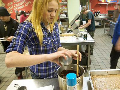 Kayla Guenette works on cheesecake-topped brownies Monday for a special luncheon Wednesday at the Bath Regional Career and Technical Center in observance of Autism Awareness Month. The BRCTC culinary arts cafe will reopen for one last public lunch from noon to 1 p.m. Wednesday, with $3 of every $7 meal fee to be donated to the Autism Society of Maine.
