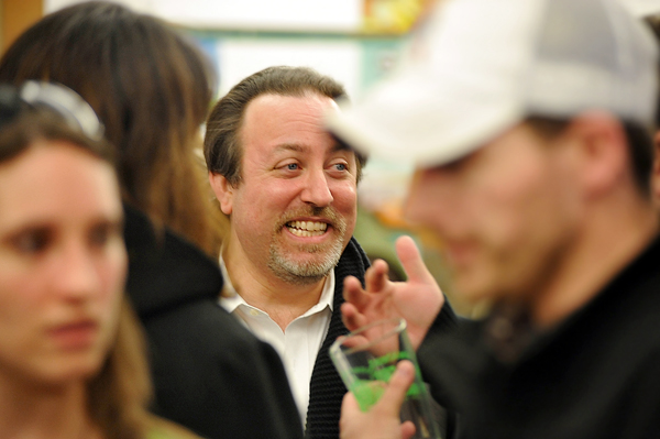 Lucas Richman, conductor of the Bangor Symphony Orchestra, mingles with fellow attendees of Bangor's Greendrinks gathering at the offices of WBRC Architects-Engineers in downtown Bangor in March.