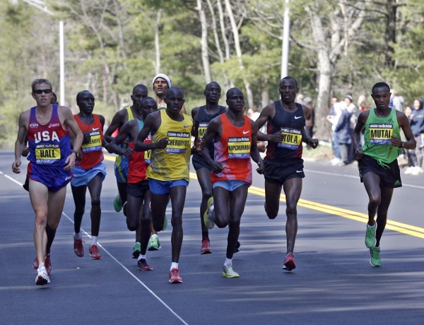 Elite male runners participate in the 115th Boston Marathon in Wellesley, Mass., Monday, April 18, 2011.