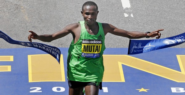Geoffrey Mutai of Kenya breaks the tape to win the men's division at the finish line of the 115th Boston Marathon in Boston, Monday, April 18, 2011.
