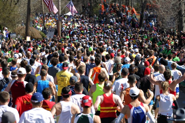 Runners start the 115th running of the Boston Marathon, in Hopkinton, Mass., Monday, April 18, 2011.