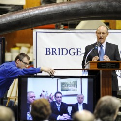 Cianbro CEO Peter Vigue (right)  moderated a teleconference with Habib Dagher (video screen,center), former  Maine D.O.T. Commisioner  David Cole (video screen, left) and Advanced Infrastructure Technologies President and C.E.O.  Brit Svoboda (video screen, right). The three were waylaid at an airport Friday morning as they made their way back from Washington D.C. where Thursday night Habib Dagher, director of the Advanced Wood Composites Center, picked up the prestigious Pankow Award from the American Society for Civil Engineering