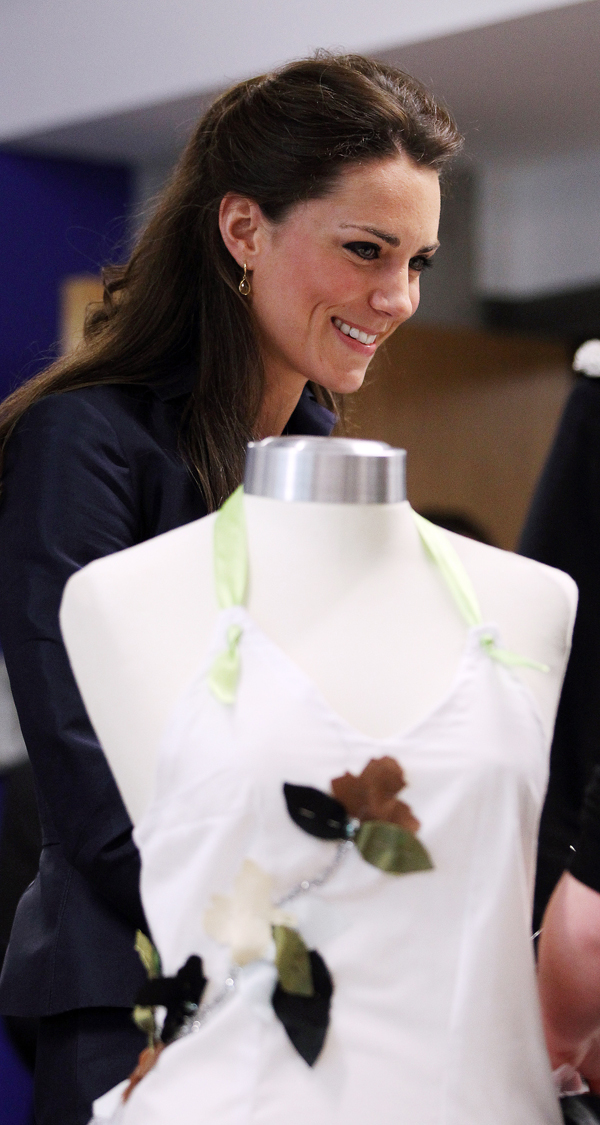 Kate Middleton, fiancee of Britain's Prince William, stands behind a dress mannequin in a textile class during a visit with William to Darwen Aldridge Community Academy in Darwen, north-west England.