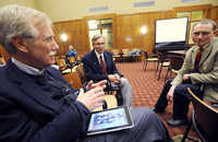 Former governor Angus King left, discusses the merits of Ipad technology in early education with Auburn schools superintendant Tom Morrill center,and Auburn schools director of technology Peter Robinson right, during a presentation by Apple to the Auburn School committee on Wednesday.