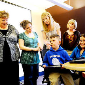 Mauri Dufour, a K-6 literacy interventionist (right) reacts to the candidness of Lucius Rice, 6, a kindergartener at Washburn Elementary in Auburn, as he shows Auburn School District kindergarten teachers (from left to right) Sue LaRue, Amy Heimerl, Kelly McCarthy, Joanna Wallingford, and Laurie Gerard the aps he uses on Dufor's iPad. The five teachers received iPads Tuesday and will pilot the program where all Auburn kindergarteners will receive iPads next year. To see a video of Lucius using the iPad, visit www.sunjournal.com.