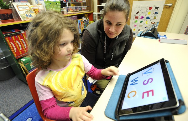 Rhianah Landry, 5, a kindergarten student at Washburn Elementary School in Auburn works with literacy instructor Mauri Dufour using letter identification program on an iPad tablet on Thursday, April 7, 2011.