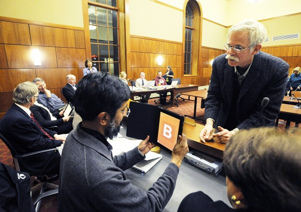 David Das, left, chairman of the Auburn School Committee, is given a demonstration of the iPad 2 tablet computer by  Jim Moulton, an education development executive from Apple, at a School Committee meeting Wednesday night.