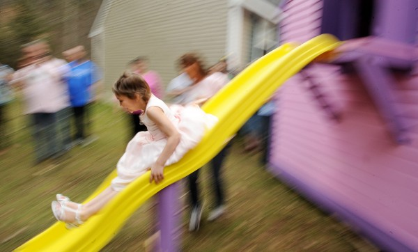 Nine-year-old Caitlin McKenney was so happy with her new playouse she had to ride down the slide before she took off her pink dress at her Harmony home Friday afternoon.  Hundreds of people lined the streets and participated in a parade that was held in her in her honor. The playhouse was donated by the Make-A-Wish Maine Foundation and was a complete surprise to her.  Caitlin has cancer and had to have one of her kidneys removed but the desease is now in remission.