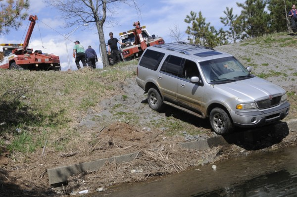 Union Street Towing dispatched two wrecker trucks to pull a SUV from the  canal off Maine Avenue near Bangor International Airport Friday afternoon. Police said the driver lost power steering and braking and his vehicle went into the canal and was partially submerged. The driver appeared unhurt.