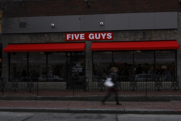 Five Guys Burgers and Fries is the latest chain to open in the Old Port, a Portland retail icon that is still largely dominated by locally owned businesses.