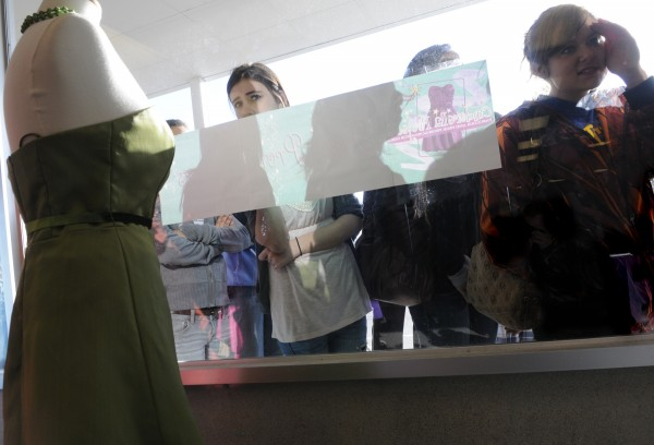 Kourtney Clendenning (left), 16, and Shawna Dakin (right), 16, of Searsport peered through the window to get a sneak peak before the doors opened at 8 a.m. for the 6th annual Cinderella Project of Maine prom dress giveaway at Reny's Plaza in Belfast Saturday morning, April 9, 2011.