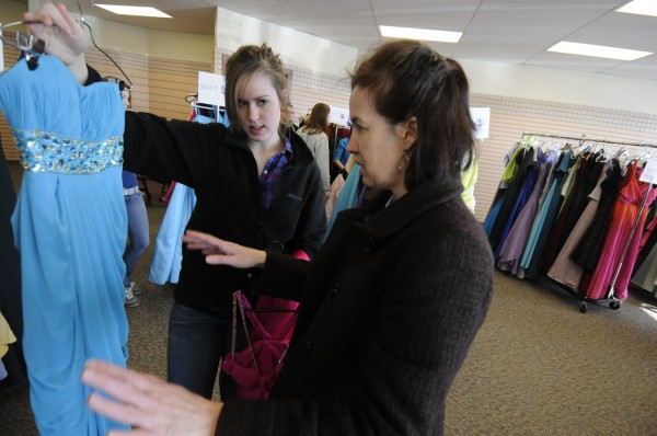 Maryellen Applebee (left), 15, a Bangor High School freshman, gets feedback from her her mom, Darla Applebee as they search for the perfect prom dress during the 6th annual Cinderella Project of Maine prom dress giveaway at Reny's Plaza in Belfast Saturday morning, April 9, 2011.