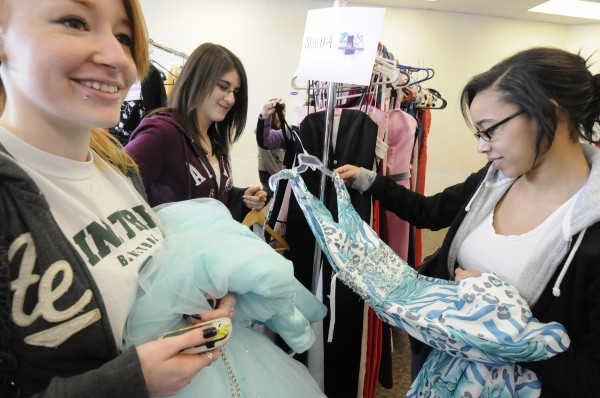 Maria Hustus (left), 17, of Searsport and Hannah Betit (right), 17, of Searsport get help with their prom dress selections from friend and volunteer Alicia Lane (center) of Searsport during the 6th annual Cinderella Project of Maine prom dress giveaway at Reny's Plaza in Belfast Saturday morning, April 9, 2011.