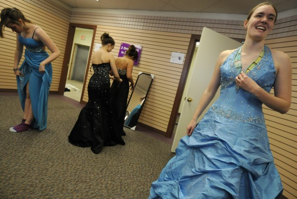 Mount View High School junior Amanda Larrabee (right) shows off a blue prom dress to friends and family as Bangor High School freshman Maryellen Applebee (left) and others try on their selections during the 6th annual Cinderella Project of Maine prom dress giveaway at Reny's Plaza in Belfast Saturday morning, April 9, 2011.