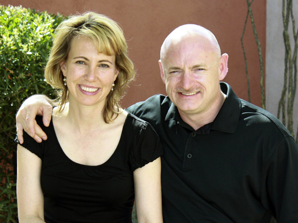 Gabrielle Giffords with her husband, NASA astronaut Mark Kelly. Aides to Giffords have been preparing for her to travel to Florida to watch her husband's space shuttle launch planned for the end of April, although doctors have yet to clear her to go.