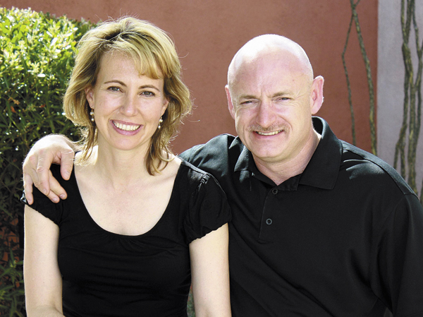 Rep. Gabrielle Giffords, (left) with her husband, NASA astronaut Mark Kelly. Giffords will attend her husband's space shuttle launch in Florida on Friday.  The Arizona congresswoman will travel for the first time since she was flown from Tucson to Houston more than three months ago to recover from a gunshot wound to the head.
