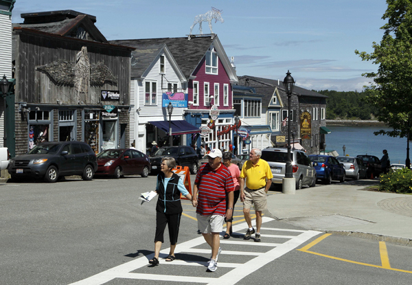Tourists stroll through Bar Harbor, Maine, during a visit by the cruise ship Maasdam in June 2010.