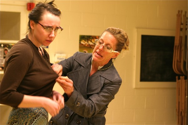 Matchmaker Frosine (Jennifer Hodgson) begins the transformation of Mariane (Abby Norman) from Ugly Duckling to Swan.