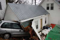 Melanie York of Livermore Falls and four children escaped serious injury Wednesday after the brakes in the van they were riding in failed to work. The van came down a steep Spring Street in Livermore Falls, crossed High Street, went through a one-car garage, down an embankment and into house on School Street.