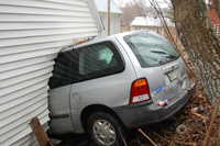 A minivan lost its brakes on steep Spring Street in Livermore Falls on Wednesday and went through the back of a garage on High Street and down into a house on School Street.