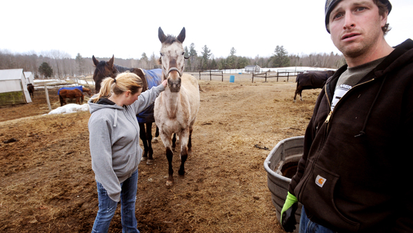 Brett Ingraham (right) and his wife, Alexis (left) run Fair Play Farm, a horse farm in Clinton.
