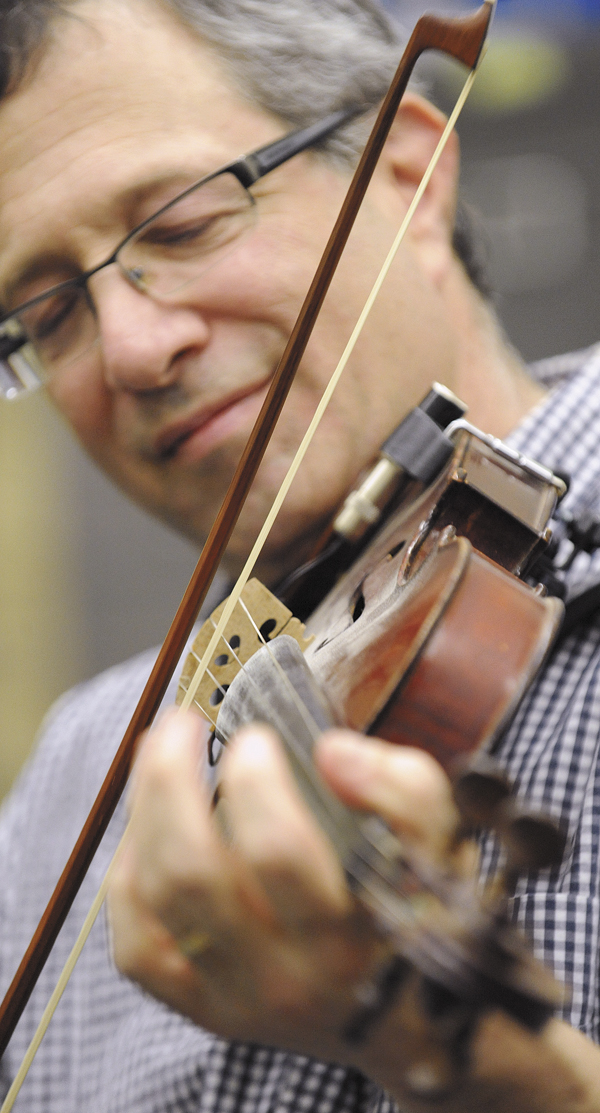 Jeffrey Silverstein a member of the Penobscot Fiddles during rehearsal for the Penobscot County Fiddler's Showcase concert that will be held at Saturday  at the Bangor Grange Hall.