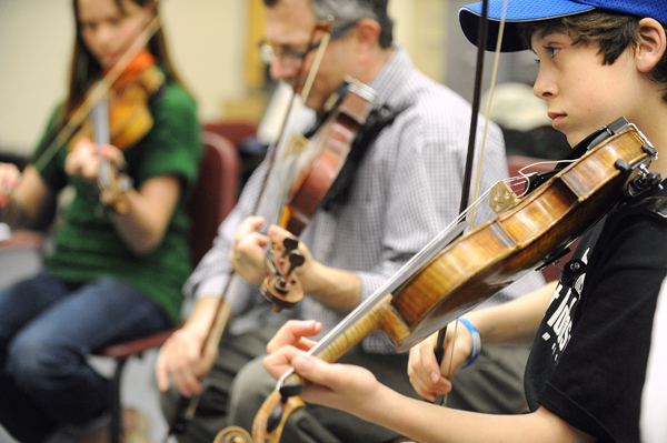 Max Silverstein (right) and other members of the Penobscot Fiddles during rehursal for the Penobscot County Fiddler's Showcase concert that will be held at Saturday  at the Bangor Grange Hall.
