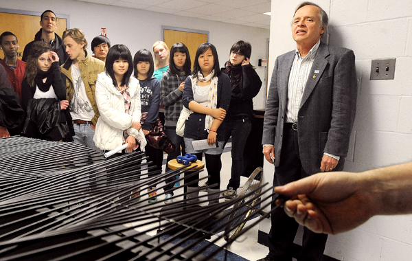A group of foreign students from Orono High School, John Bapst, and Lee Academy watch a demonstration of different waves at Bennett Hall at the University of Maine in Orono. Students representing ten countries toured the school which is hoping to attract them to continue their studies there.  On the right is David Batuski the chair of the Department of Physics and Astronomy.