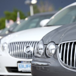 A row of 2009 Buick Lacrosse sedans at a General Motors dealership in the south Denver suburb of Englewood, Colo. General Motors will retake the title of world's largest car company this year.